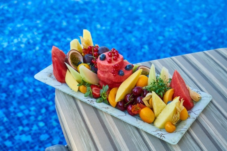 Fruit tray outside freshly cleaned pool